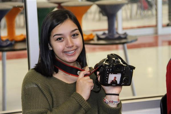 Junior Adriana Rios showcases her video project, All About Macy