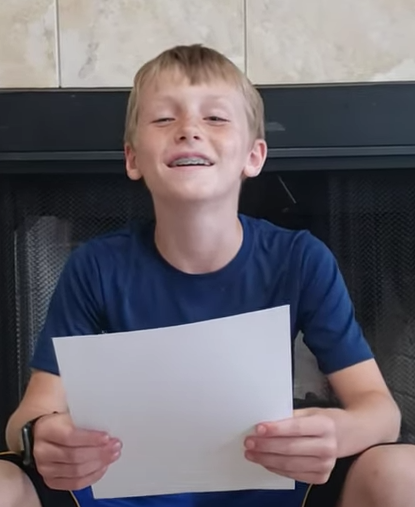 "Fourth Grader Noah Voskuil showcases his ""Super Puppy Poem."""