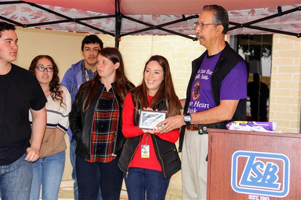 2-8-2019  Lytle Art Students Partner with Lytle State Bank to Design Purple Heart Parking Space