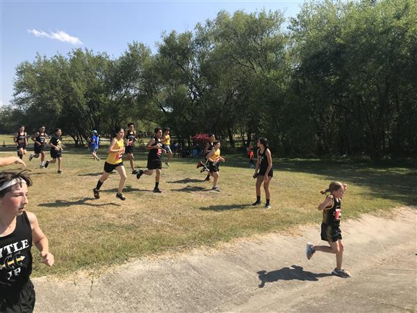 The boys encouraging Samantha Guerrero at the finish. (picture taken by Coach McCarthy)