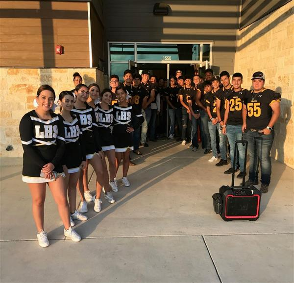 High School Cheer squad and Football team greets Elementary students for a great Friday.