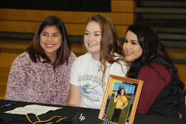 Shyane and others smile after signing with her chosen college.