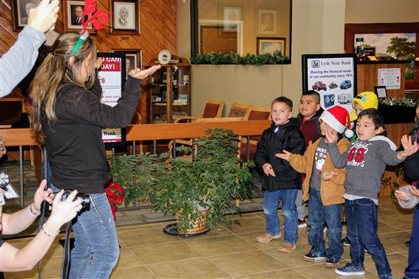 Primary students spread some holiday cheer caroling at Lytle State Bank