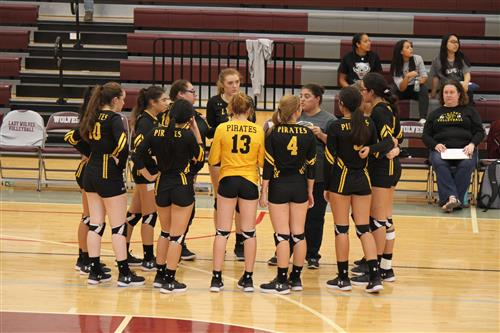 Varsity Volleyball in Huddle.