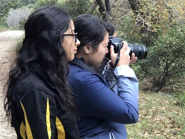 Commercial photography students capturing nature photos.