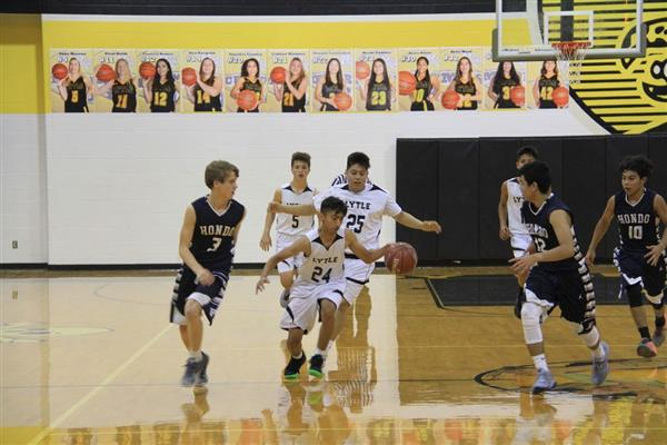 JV boys hustle on the court.